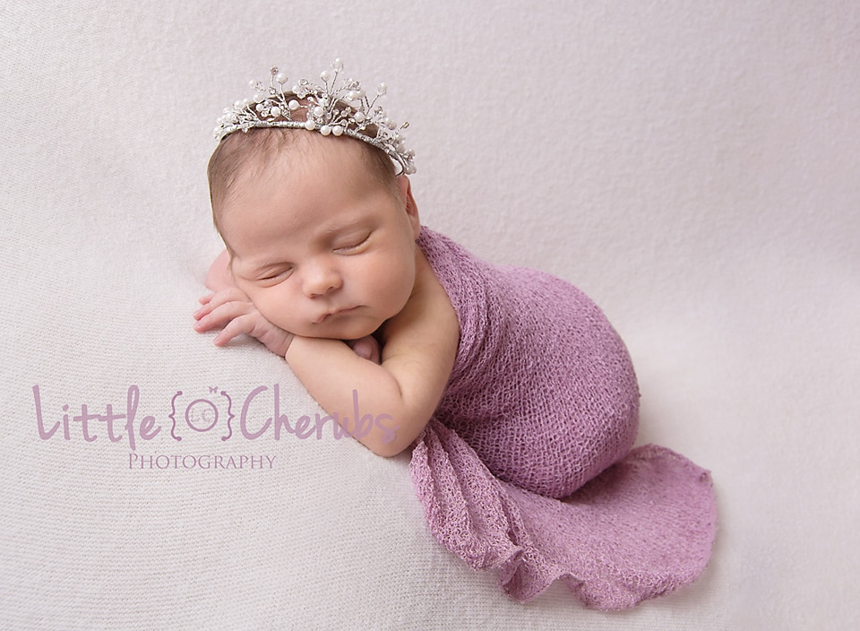 Newborn baby in tiara peterborough baby photographer
