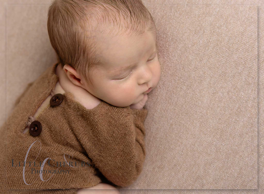 picture of newborn baby boy sleeping on cream blanket cute new baby photo shoot peterobrough cambridge ely