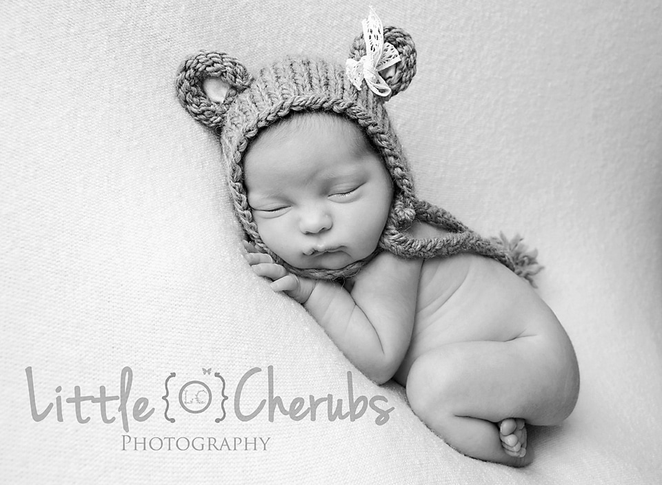 Newborn girl in bear hat march baby photographer
