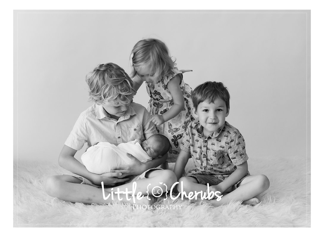 Newborn baby and siblings family photo best newborn photography cambridge ely march peterborough near wisbech