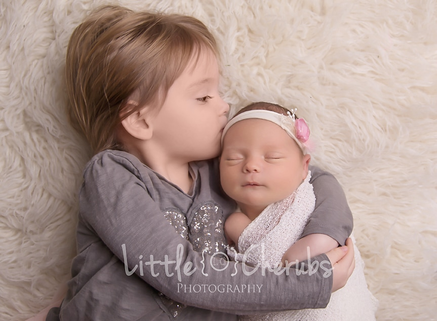 big sister siblings kiss newborn photography studio march cambridge