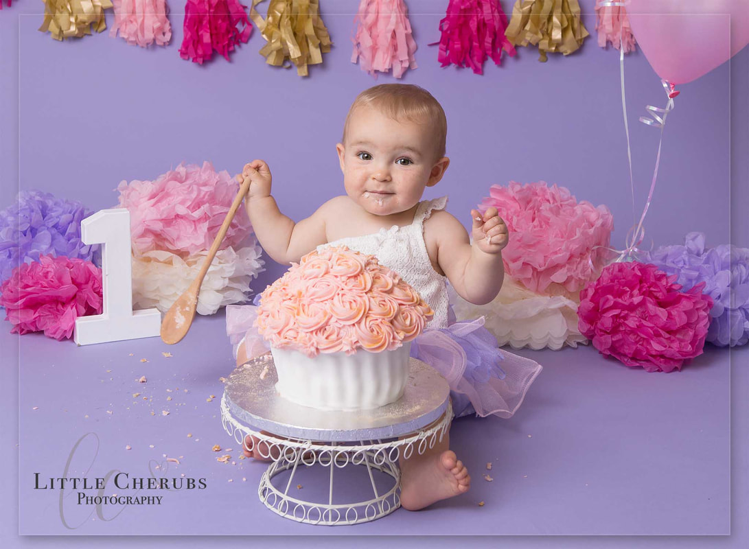 pink and purple cake smash babys first birthday photos cake smash peterborough