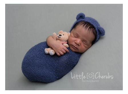 baby with bear in hat ely newborn photographer near me cambridgeshire fenland